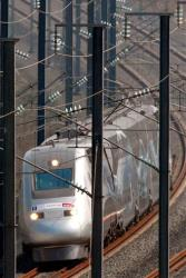 A high-speed train speeds through the Jolny viaduct, near Thionville, eastern France, on its way to break the world speed record for a conventional train near Grigny, eastern France, April 3, 2007.