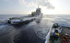 China's rescue ships conduct an offshore search operation for MH 370.