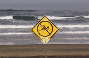 A no swimming sign is displayed in this 2013 file photo.