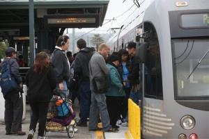 Pedestrians board a train at Union Station Friday, March 7, 2014 in Los  Angeles.