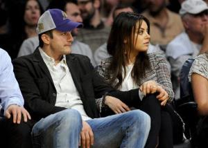 Ashton Kutcher and Mila Kunis attend an NBA basketball game between theNew Orleans Pelicans and Los Angeles Lakers, Tuesday, March 4, 2014, in Los Angeles.