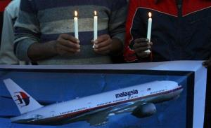 Members of the social group Christian Muslim Alliance Pakistan take part in a candlelight vigil for passengers,Tuesday, March 18, 2014 in Islamabad.