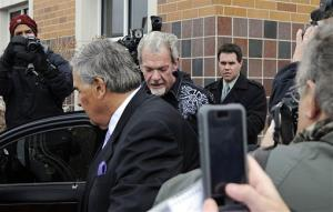 Attorney James Voyles and Indianapolis Colts owner Jim Irsay, center right, leave the Hamilton County Jail in Indianapolis, Monday, March 17, 2014.