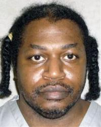 This June 29, 2011 photo provided by the Oklahoma Department of Corrections, shows Charles Warner.