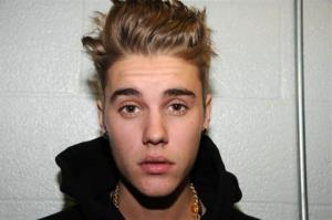 This Jan. 23, 2014 file photo made available by the Miami Beach Police Dept., shows Justin Bieber at the police station in Miami Beach, Fla.