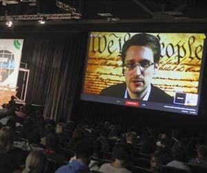 Edward Snowden talks during a simulcast conversation during the SXSW Interactive Festival, March 10, 2014, in Austin, Texas.