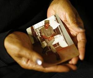 Alma Murdough holds a photo of her son, Jerome, at her home in Queens.