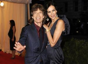 This May 7, 2012, photo shows singer Mick Jagger, left, and L'Wren Scott at the Metropolitan Museum of Art Costume Institute gala benefit, celebrating Elsa Schiaparelli and Miuccia Prada, in New York.