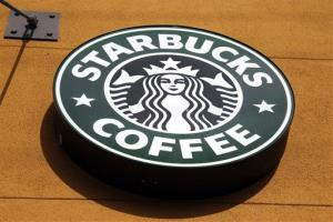 This Jan. 3, 2012 file photo shows the Starbucks Coffee logo in Mountain View, Calif.