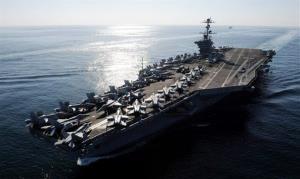 In this Nov. 12, 2011file photo, the Nimitz-class aircraft carrier USS John C. Stennis (CVN 74) transits the Straits of Hormuz.