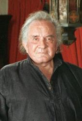 In a 1999 file photo, the late country music legend Johnny Cash poses at his Hendersonville, Tenn. home.