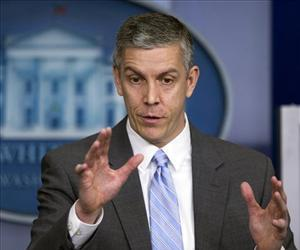 In this March 14, 2014, file photo, Education Secretary Arne Duncan speaks to reporters during briefing in the Brady Press Briefing Room of the White House.