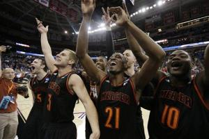 Mercer players celebrate their win over Duke.