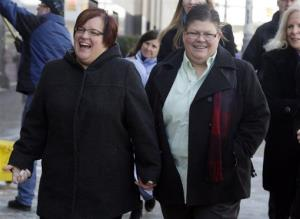 April DeBoer, left, and her partner Jayne Rowse hold hands after closing arguments in their trial on March 7.