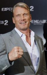 Swedish actor Dolph Lundgren poses for the photographers during a photo call to promote the film The Expendables 2 in Paris, Friday Aug. 10, 2012.