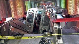 A Chicago Transit Authority train car rests on an escalator at the O'Hare Airport station after it derailed early Monday, March 24, 2014, in Chicago.
