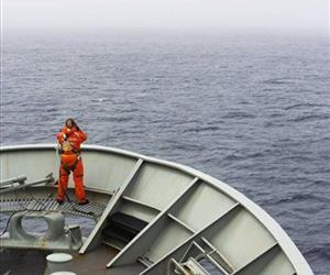 In this March 23, 2014 photo provided by the Australian Department of Defence (ADF), a lookout is stationed on bow of HMAS Success during the search in the southern Indian Ocean.