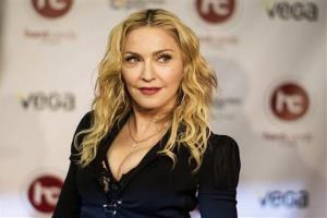 Madonna arrives at the opening of Toronto's Hard Candy Fitness, on Tuesday, Feb. 11 , 2014.