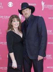 Musician Trace Adkins and his wife Rhonda arrive at the 44th Annual Academy of Country Music Awards in Las Vegas on Sunday, April 5, 2009.