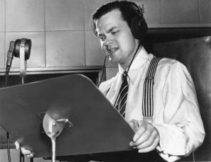 Orson Welles delivers a radio broadcast from a New York studio in 1938.