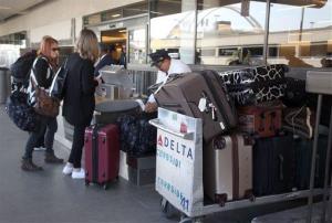Passengers are shown getting checked in before a flight Thursday March 27, 2014 at Los Angeles International Airport in Los Angeles.