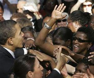 Spectators react as Democratic presidential hopeful Sen. Barack Obama, D-Ill., works the crowd during a rally on the College of Charleston campus in Charleston, SC, Jan. 10, 2008.
