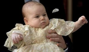 Prince George is held by Prince William as they arrive at St James' Palace in London, for the christening of the three-month-old, Wednesday, Oct. 23, 2013.