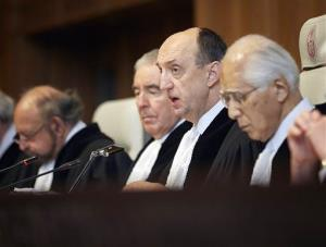 Judge Peter Tomka, center, president of the International Court of Justice, delivers its verdict in The Hague, Netherlands, Monday March 31, 2014.