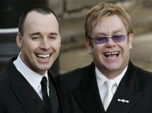 In this Dec. 21, 2005, file photo, Elton John, right, and longtime partner David Furnish smile to the media and the public after their civil ceremony, at the Guildhall in the town of Windsor, England.