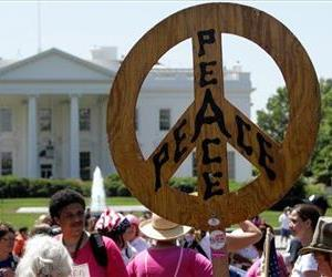 Members of the anti-war group Code Pink, and other organizations, take part in an anti-war demonstration ion front of the White House in Washington, Monday, May 14, 2007.