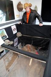 Bigfoot hunter Rick Dyer stands with what he claimed was the body of Bigfoot in Paris, Texas, on Feb. 15.