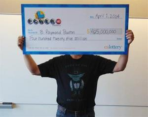 Powerball winner B. Raymond Buxton holds a check for $425 million in Sacramento. Calif.