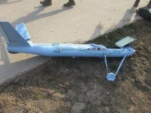 In this Monday, March 31, 2014 photo released by the South Korea Defense Ministry Wednesday, April 2, 2014, an unmanned drone lies on the ground damaged on Baengnyeong Island, South Korea.