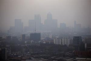 The skyscrapers of the Canary Wharf business district in London are shrouded in smog Wednesday, April 2, 2014.