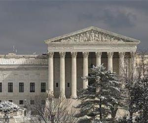 The Supreme Court is seen after a dusting of snow in Washington, Tuesday, Feb. 25, 2014.