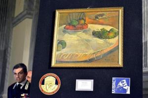 A Paul Gauguin still life recovered by authorities is shown during a press conference in Rome.