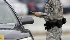 A driver is stopped at a security checkpoint at Fort Hood in this file photo.