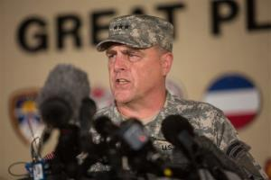 Lt. Gen. Mark Milley, the senior officer on base, speaks with the media outside of an entrance to the Fort Hood military base.
