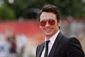 James Franco poses as he arrives on the red carpet for the film Palo Alto at the 70th edition of the Venice Film Festival held from Aug. 28 through Sept. 7, in Venice, Italy, Sunday, Sept. 1, 2013.
