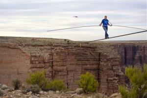 This 2013 file photo released by Discovery shows Nik Wallenda walking across the Grand Canyon.