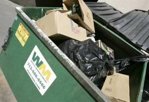 A Waste Management dumpster is full at the end of the day in Houston Thursday, April 26, 2007.