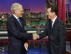 David Letterman welcomes Stephen Colbert to his show in this 2011 image.