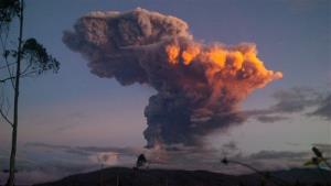 The Tungurahua volcano spews a column of ash as seen from Ambato, Ecuador.