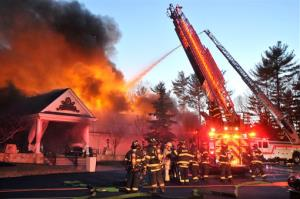 Firefighters respond to a multiple alarm fire at the popular Lakeview Pavilion in Foxboro, Mass., Saturday, April 5, 2014. A wedding was taking place at the time of the fire.