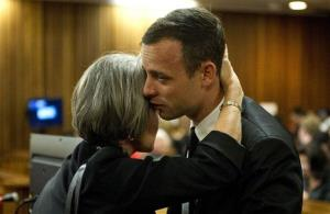Oscar Pistorius gets a hug from his aunt Lois Pistroius in court in Pretoria, South Africa, Monday, April 7, 2014.
