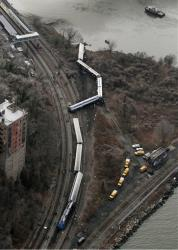 In this Dec. 1, 2013 file photo, a Metro-North passenger train lays on its side after derailing on a curved section of track  in the Bronx borough of New York.