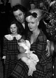 In this March 16, 1989 file photo, Bob Geldof, Paula Yates, and their daughter Fifi Trixiebelle show off the new addition to their family, Peaches, at St Mary's Hospital in Paddington, London.