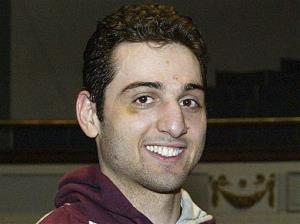 In this Feb. 17, 2010, file photo, Tamerlan Tsarnaev smiles after winning the 2010 New England Golden Gloves Championship in Lowell, Mass.