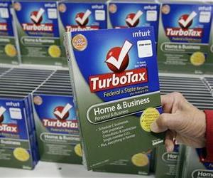 Customer looks at a copy of TurboTax on sale at Costco in Mountain View, Calif., Jan. 24, 2012.