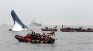 South Korean coast guard officers try to rescue passengers from the ferry Sewol in the water off the southern coast near Jindo, south of Seoul, South Korea.